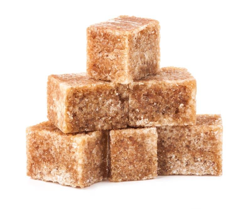 Cubos do açúcar de bastão de Brown foto de stock