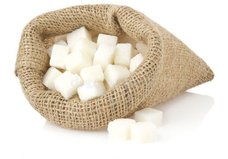 Cubos do açúcar no branco imagem de stock