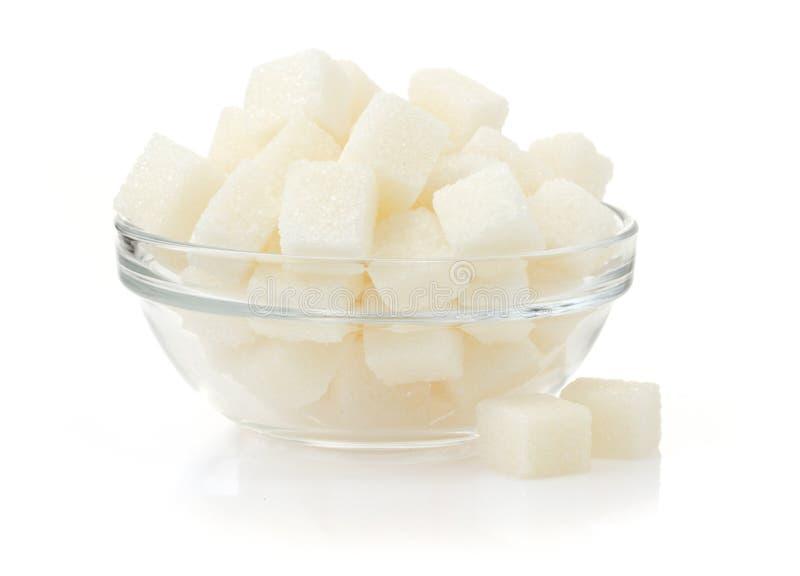 Cubos do açúcar no fundo branco imagem de stock royalty free