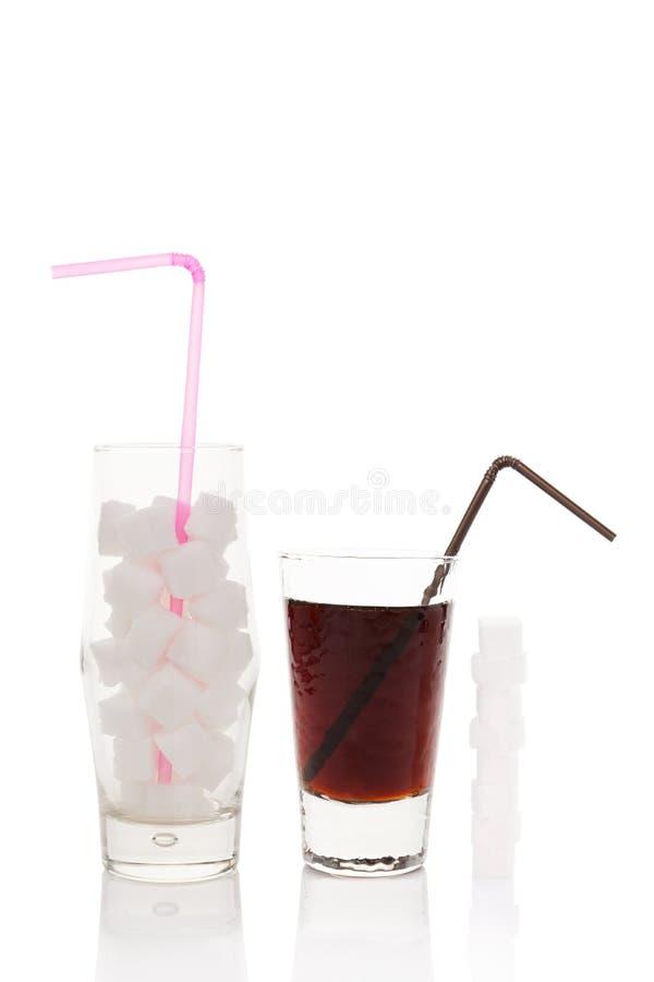 Cubos do açúcar no vidro fotos de stock royalty free