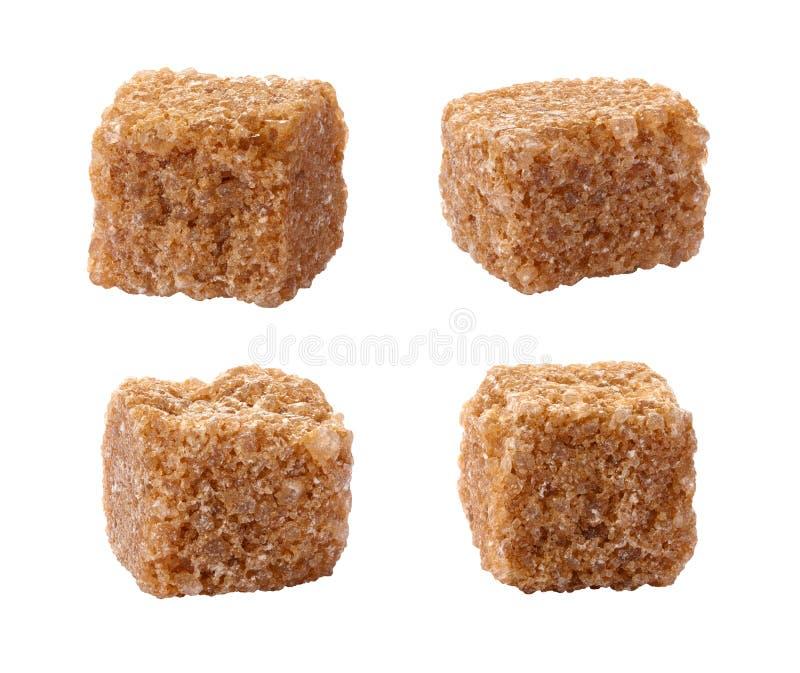 Cubos puros de la caña de azúcar aislados en blanco imagen de archivo