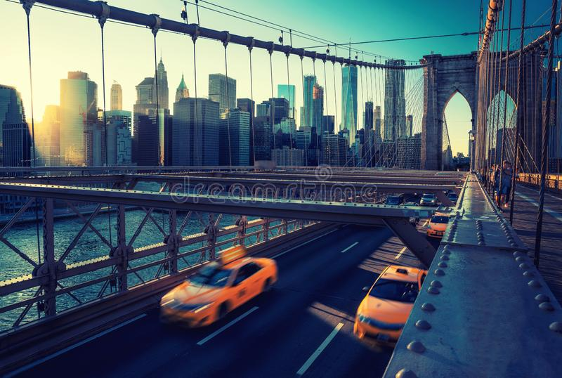 Cubs speeding at sunset on Brooklyn Bridge, Manhattan. One of the most iconic bridges in the world, New York City royalty free stock photography