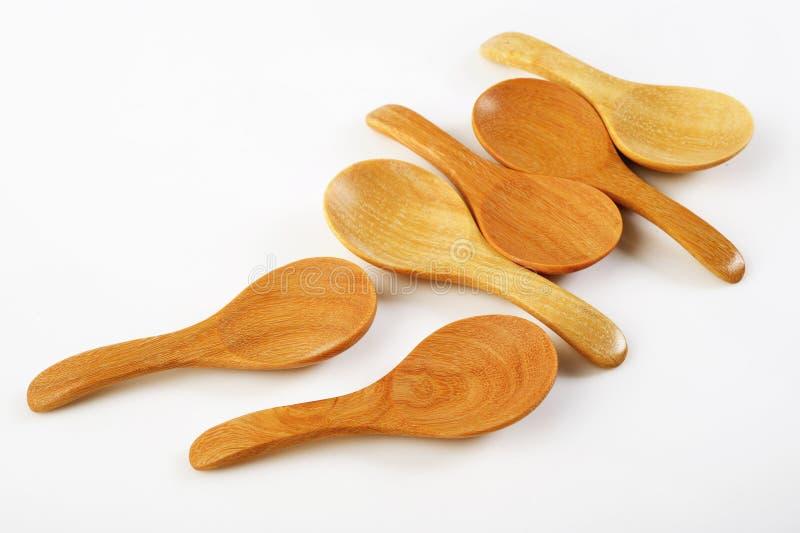 Cucchiaio di legno su bianco immagine stock