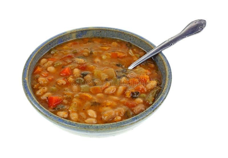 Cucchiaio di verdure italiano della ciotola della zuppa di fagioli immagine stock