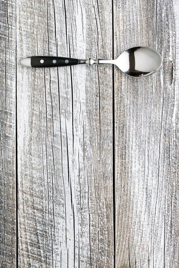 Cuchara de plata en la tabla vieja fotografía de archivo