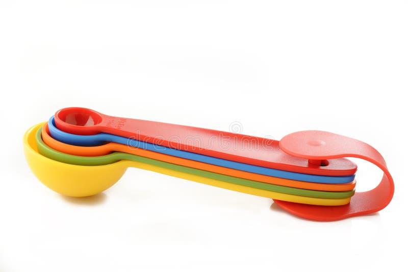 Cuchara dosificadora plástica colorida fotos de archivo