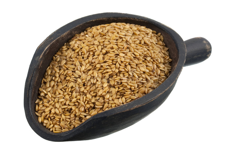 Cucharada de las semillas de lino de oro imagenes de archivo