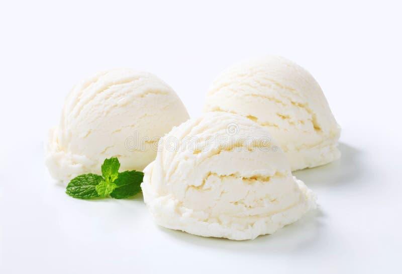 Cucharadas del helado blanco imagen de archivo libre de regalías