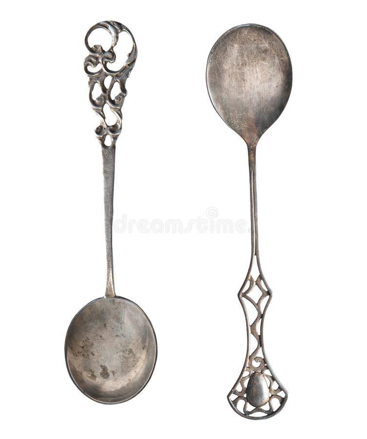 Cucharas de plata viejas hermosas aisladas en blanco Cubiertos retros fotos de archivo libres de regalías