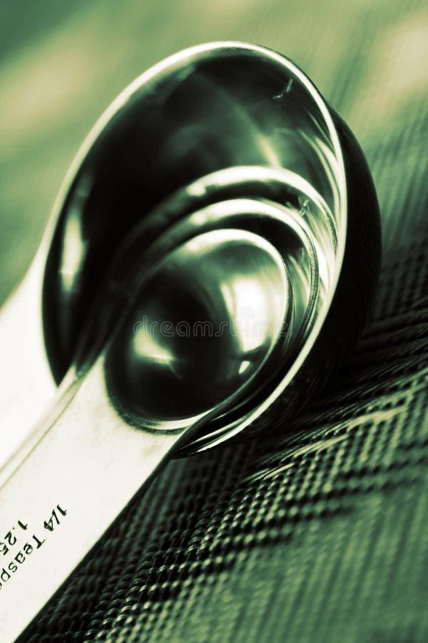 Cucharas dosificadoras fotografía de archivo libre de regalías