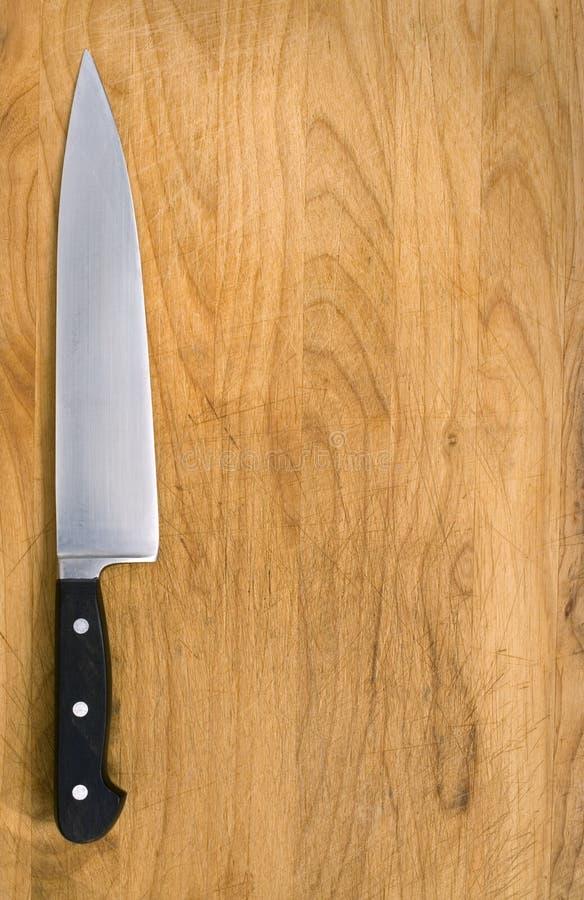 Cuchillo de cocina en bloque del corte. fotografía de archivo libre de regalías