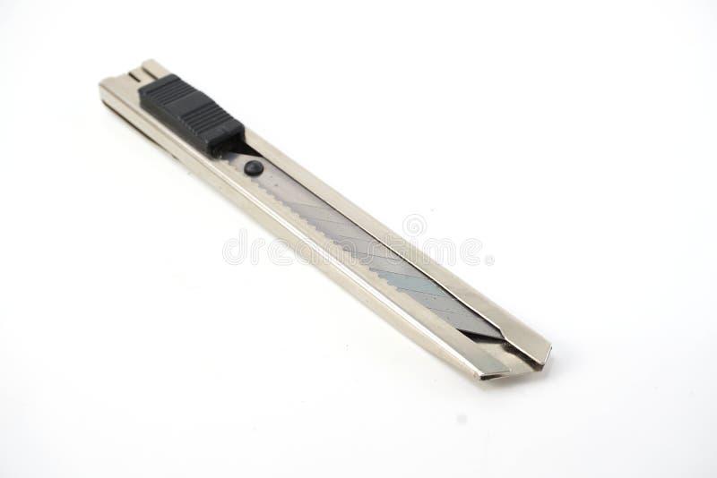Cuchillo del cortador aislado en el fondo blanco foto de archivo