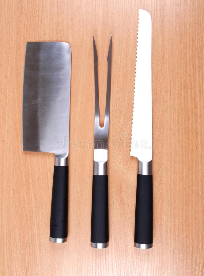 Cuchillo en el cuadro cuatro imagenes de archivo