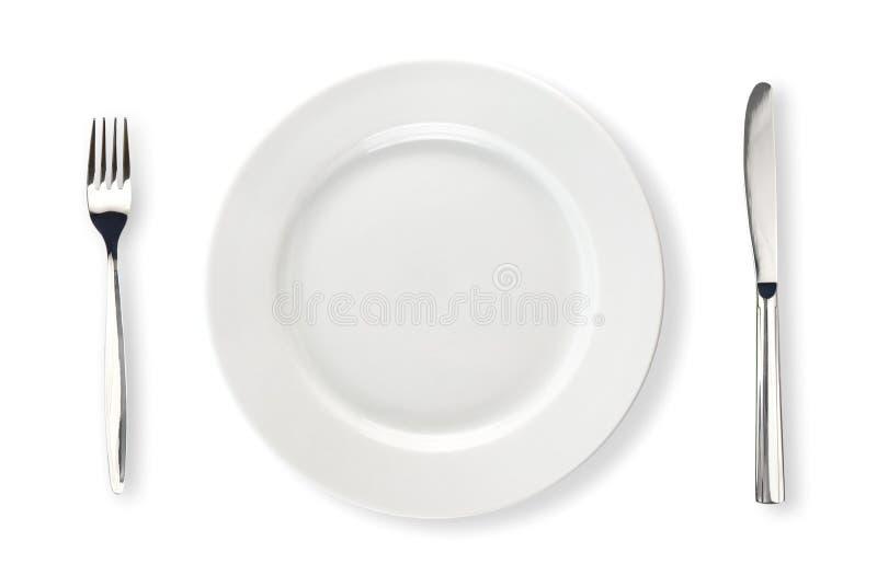 Cuchillo, placa blanca y fork aislados fotografía de archivo libre de regalías