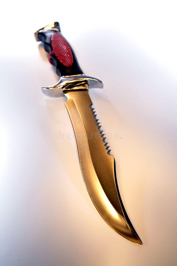 Cuchillo sostenido foto de archivo