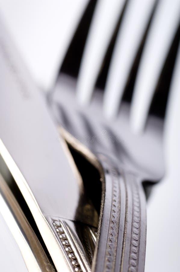 Cuchillo y bifurcación en blanco fotografía de archivo