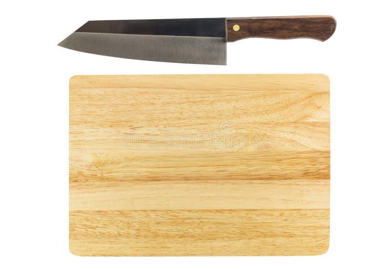 Cuchillo y tabla de cortar aislados en el fondo blanco imagen de archivo