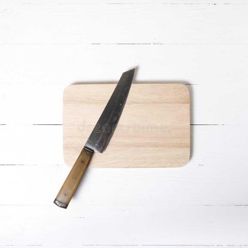 Cuchillo y tarjeta de corte fotografía de archivo