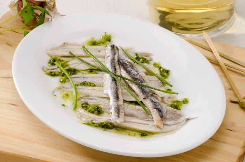 Cucina spagnola. Acciughe fresche marinate. Boquerones. fotografia stock