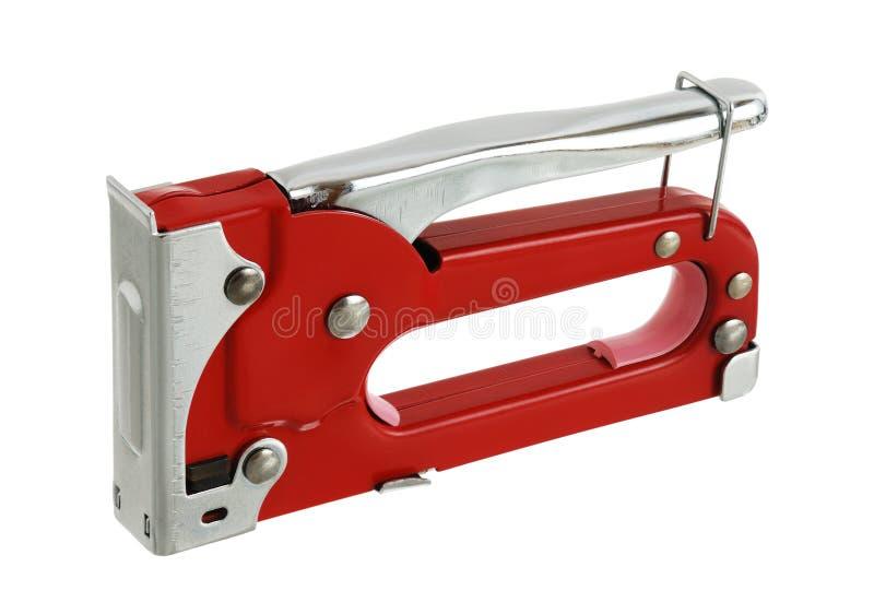 Cucitrice meccanica rossa del carpentiere nella posizione di sicurezza immagini stock libere da diritti