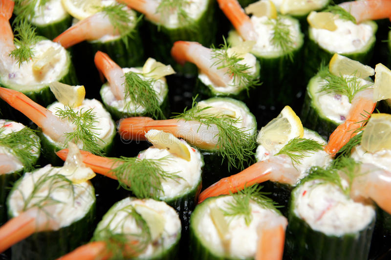 Cucumber bakquet food. Banquet appetizing food, celebration party food styling royalty free stock image