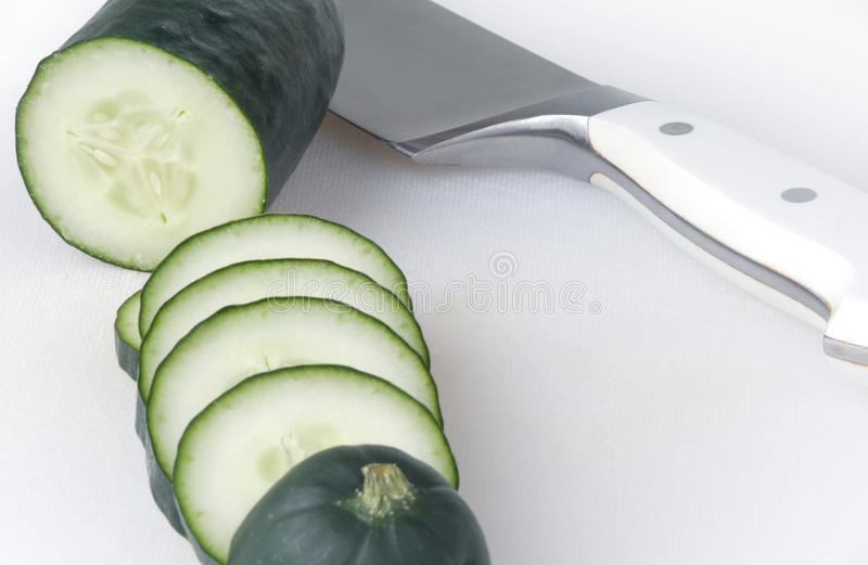 Cucumber On Cutting Board With Chef S Knife Royalty Free Stock Photography