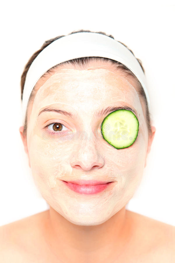 Cucumber on eye. A picture of a young relaxed woman with her eye covered with cucumber royalty free stock images