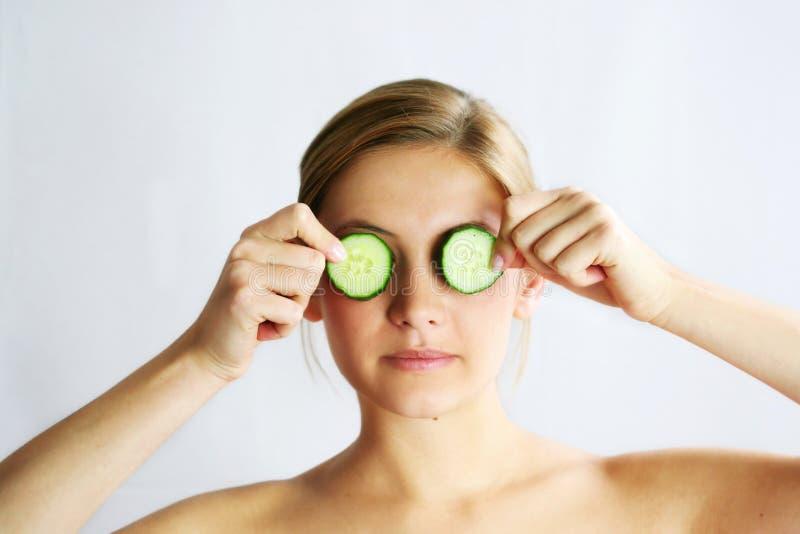 Cucumber face mask stock photo