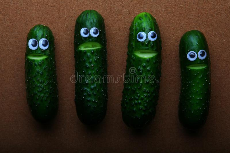Cucumber face wooden background studio. Quality stock photography