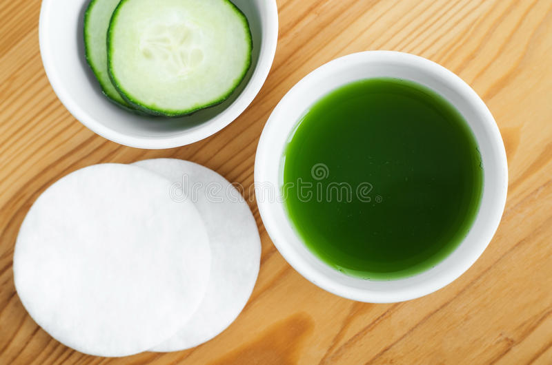 Cucumber juice in a small ceramic bowl for preparing natural facial toner. Homemade cosmetics. royalty free stock images