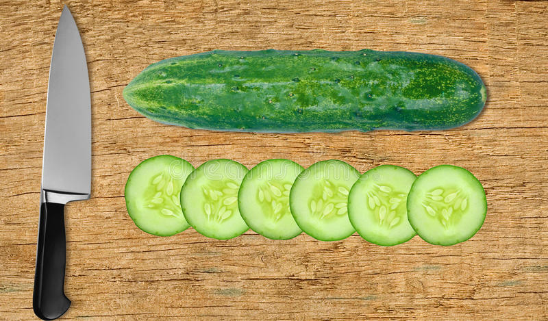 Cucumber and knife on cutting board isolated on white. Background stock images