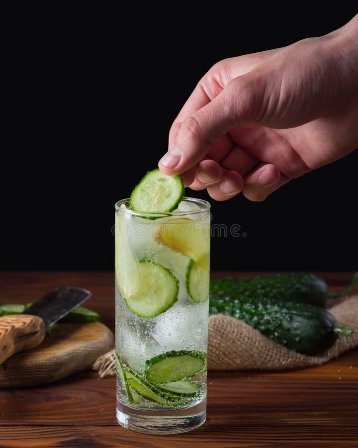 Cucumber lemonade with ice. stock photos