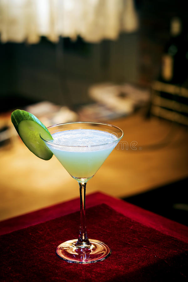 Cucumber mint modern trendy martini cocktail in bar. At night stock images