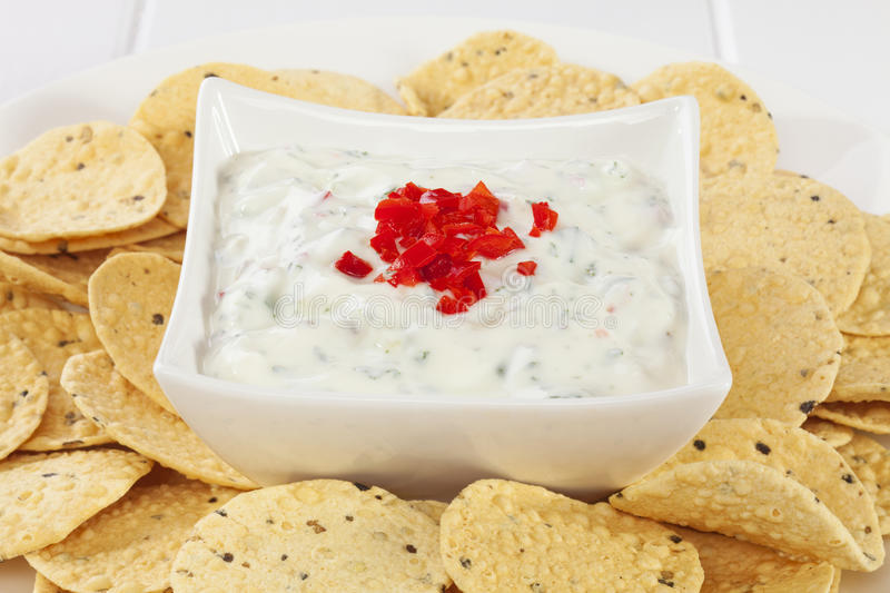 Cucumber Raita with Mini Poppadums. Popular accompaniment to Indian meals, cucumber raita topped with chilli, surrounded by mini poppadums for dipping stock images