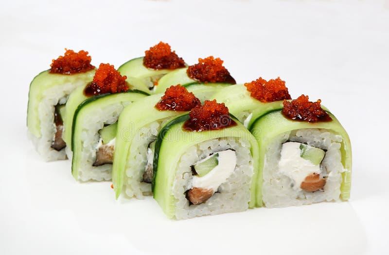 Cucumber roll salmon, cucumber, Philadelphia cheese, Unagi sauce, Tobiko stock photo