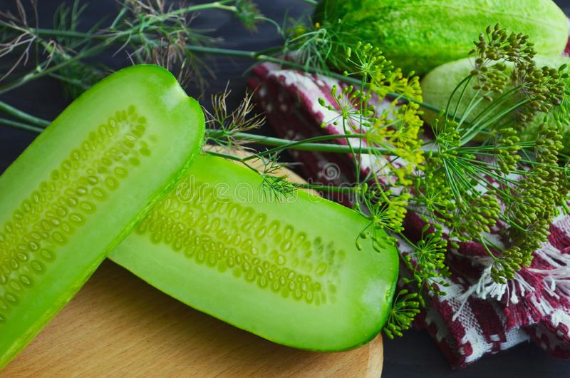 Cucumber sliced on the cutting board, salad ingredient, fresh cucumbers on a table stock photos