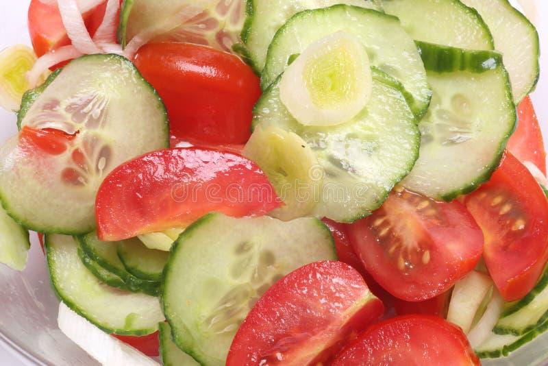 Cucumber Tomato Salad Closeup. Sliced cucumber , onion and tomato salad closeup royalty free stock photography
