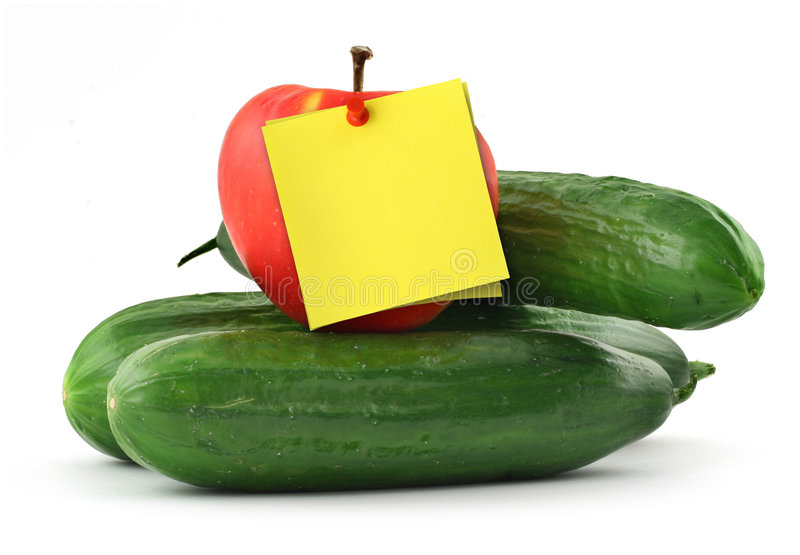 Cucumbers apple and note stock photos