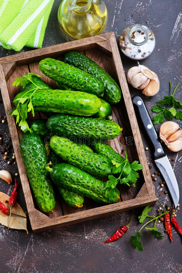 Cucumbers. In box and on a table stock images
