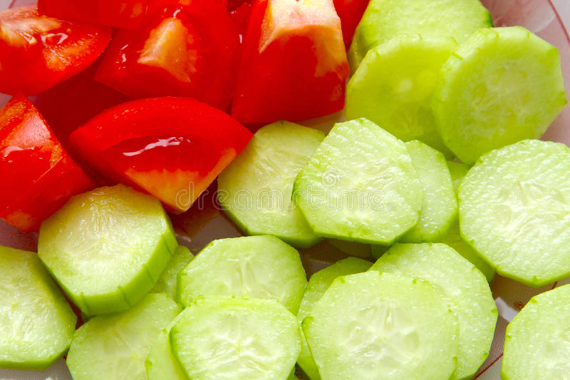 Cucumbers and tomatoes stock images