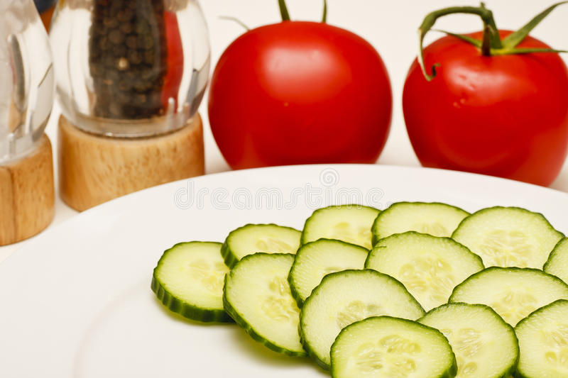 Cucumbers on White Plate with Tomatoes