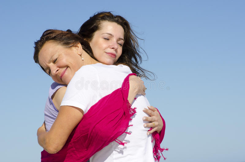 Cuddle And Hug Mother And Daughter Royalty Free Stock Images