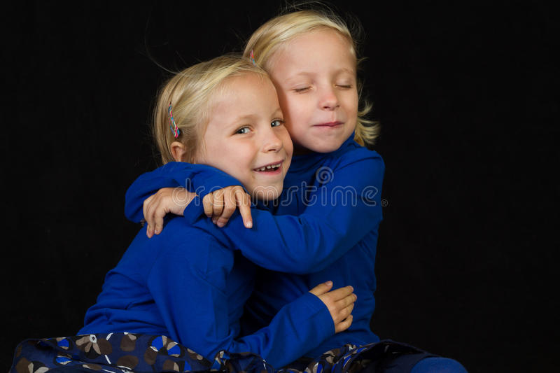 Download Cuddling twins twins stock photo. Image of cuddling, wind - 26981528