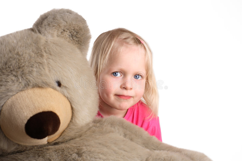 Cuddly toy. And little child royalty free stock images