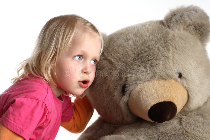 Cuddly toy. And little child stock photos