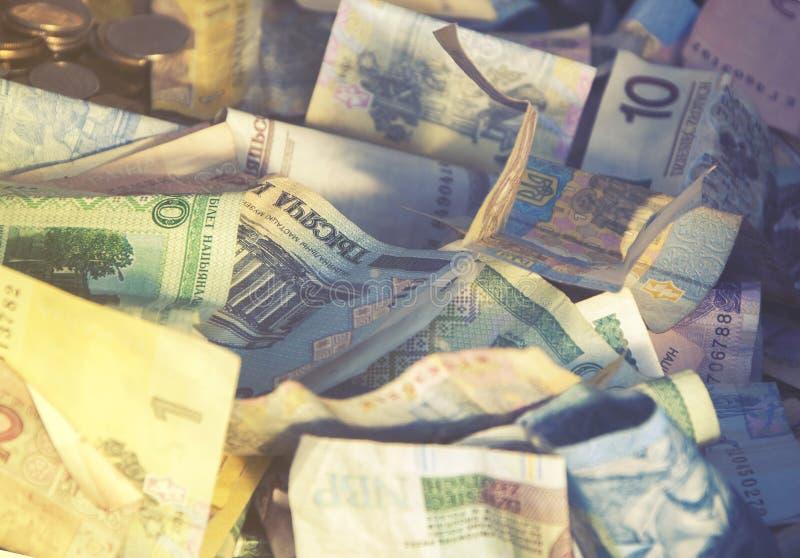 Cudzoziemskiego pieniądze kolażu tło Banknoty od różnych krajów zdjęcie stock