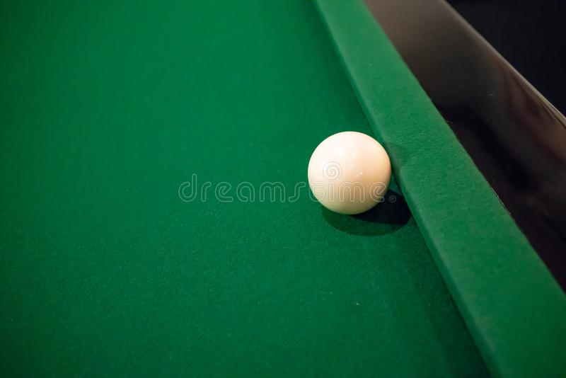 Cue ball on cushion on green snooker table. royalty free stock photo