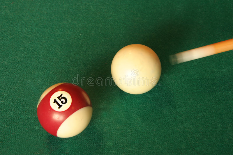 Cue driving pool balls royalty free stock photos