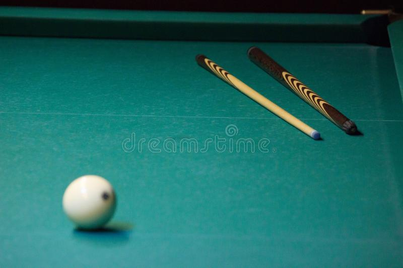 Cue and white balls for Russian Billiards are on table waiting for players and judges. competitions in sports, Hobbies, leisure stock photography
