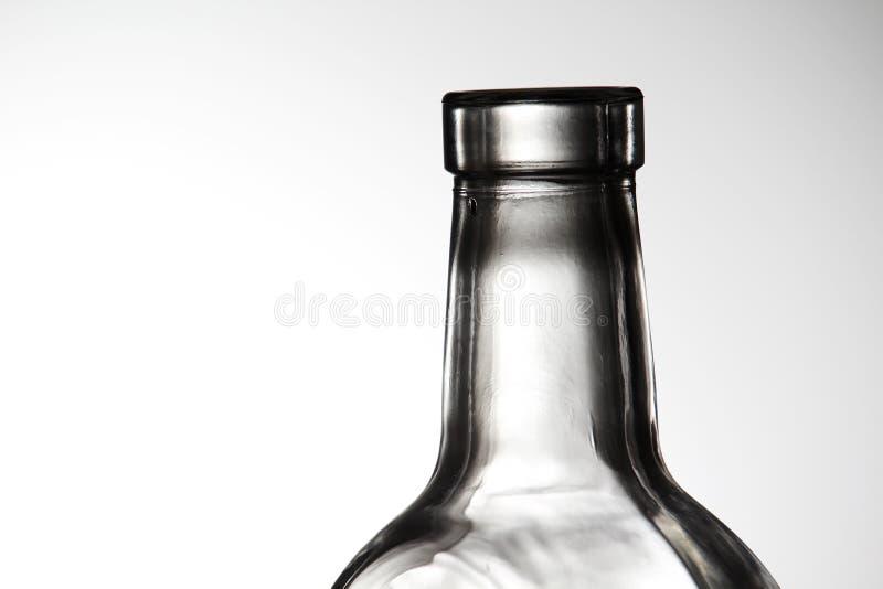 Cuello de la botella de cristal del contraste fotografía de archivo